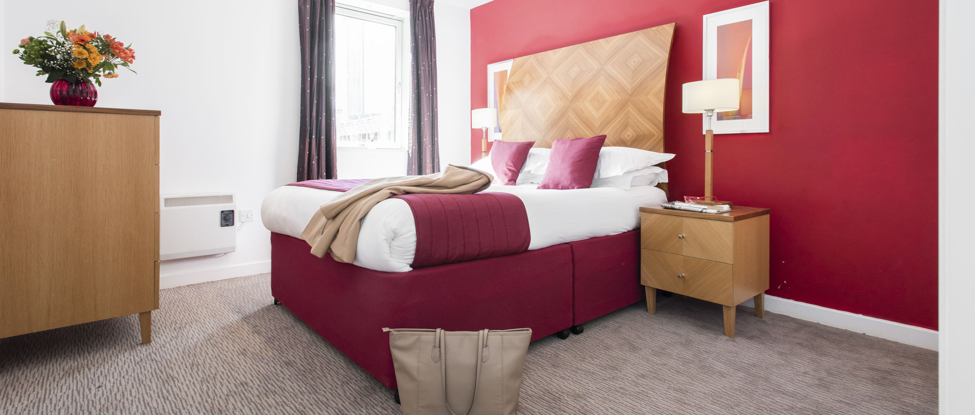 A women coat on the bed of PREMIER SUITES Birmingham serviced apartment