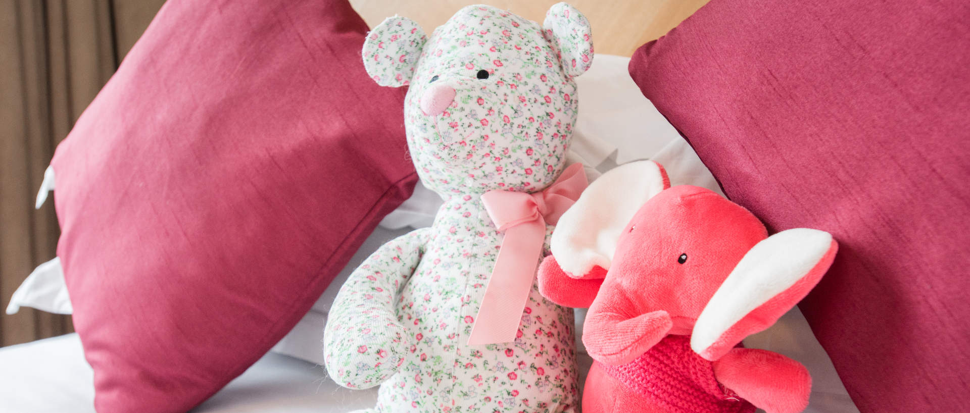 Teddies on the bed of PREMIER SUITES Birmingham family serviced apartment