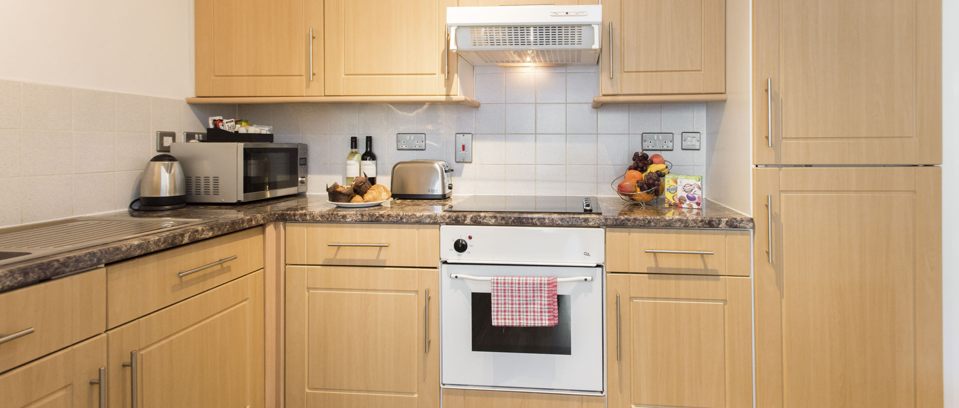 PREMIER SUITES Birmingham fully equipped kitchen
